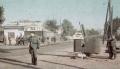 Форпост на перекрёстке улиц. На тротуаре немцы обыскивают прохожих.